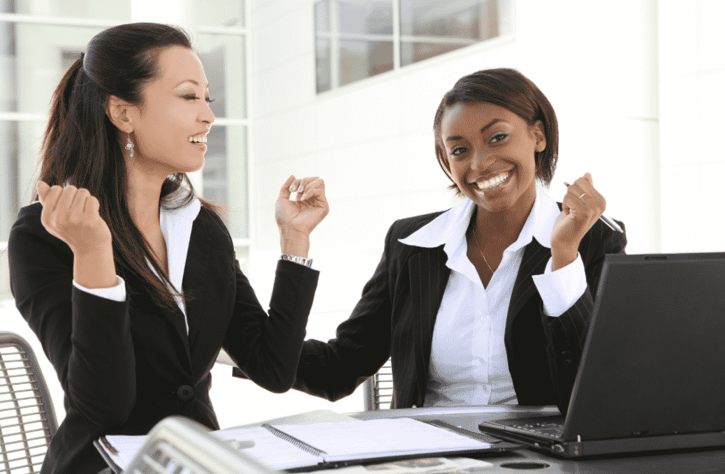 professional women holding up hands excited about new job