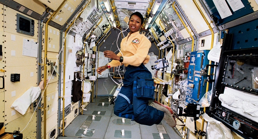 Doctor Mae Jemison floating in spacesuit