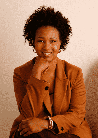 Dr Mae Jemison seated resting hand on chin