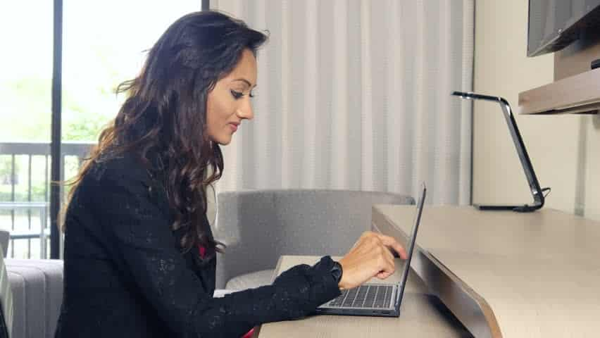 Professional woman working at desk with laptop