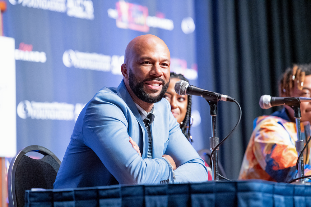 Common seated at the panel at the Black Caucus