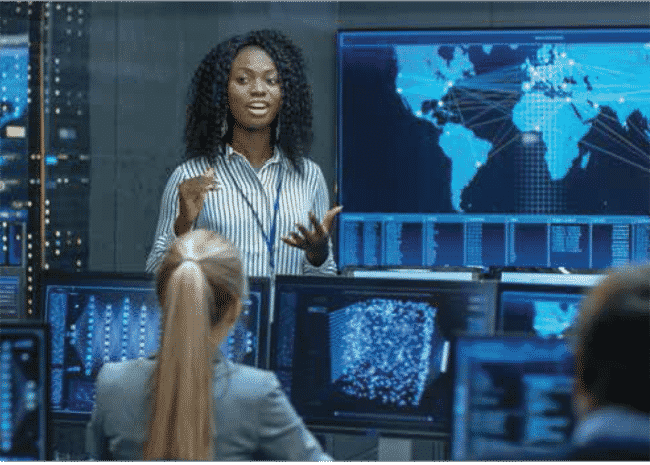 women giving class instruction with a technology image in the background
