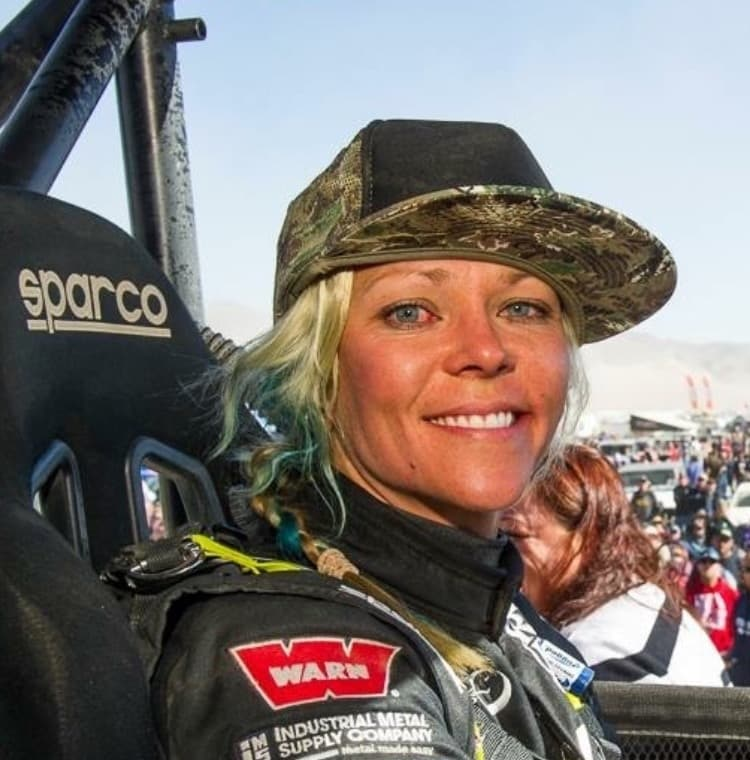Jessie Combs seated in race car before a race