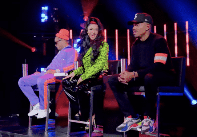Cardi B, Chance the Rapper and TI sitting in chais onstage