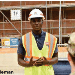 Samuel Coleman pictured wearing hard hat and construction vest