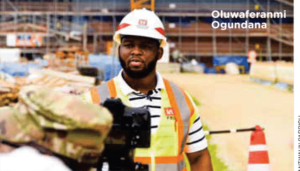 Oluwaferanmi Ogundana pictured on construction site wearing hard hat and construction gear