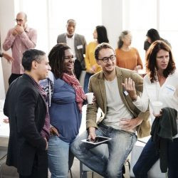 Group of diverse co-workers standing around talking