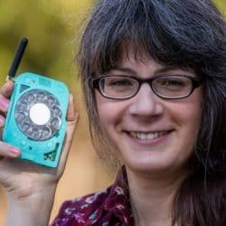 34-year-old engineer Justine Haupthas buholds her teal colored mobile phone with a rotary dial