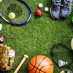 An array of sports equipment sitting on the grass